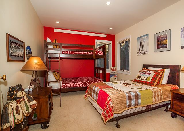 The first guest bedroom sleeps three with a bunk bed and a twin-sized bed.