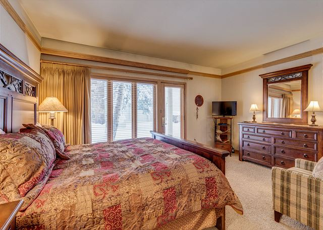 The spacious master bedroom features a king-sized bed, flat screen TV and a private entrance.