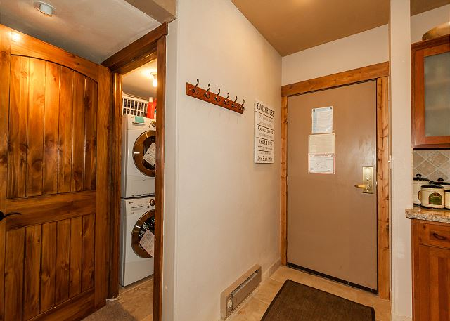 Guests have access to private laundry near the entryway.