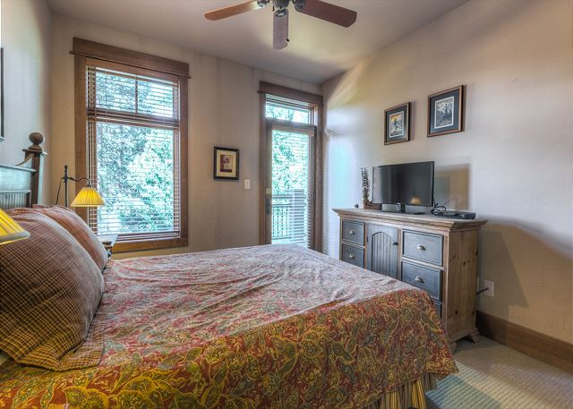 The guest bedroom features a queen-sized bed, flat screen TV and its own access to the balcony.