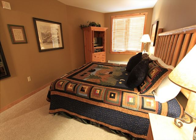 Guest bedroom features a king-sized bed and a flat screen TV.