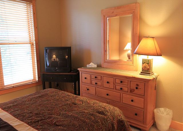 Master bedroom features a queen-sized bed and television.