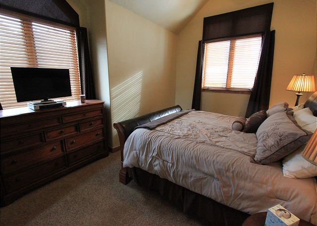 The master features a king-sized bed and a flat screen TV. (new photo coming soon)
