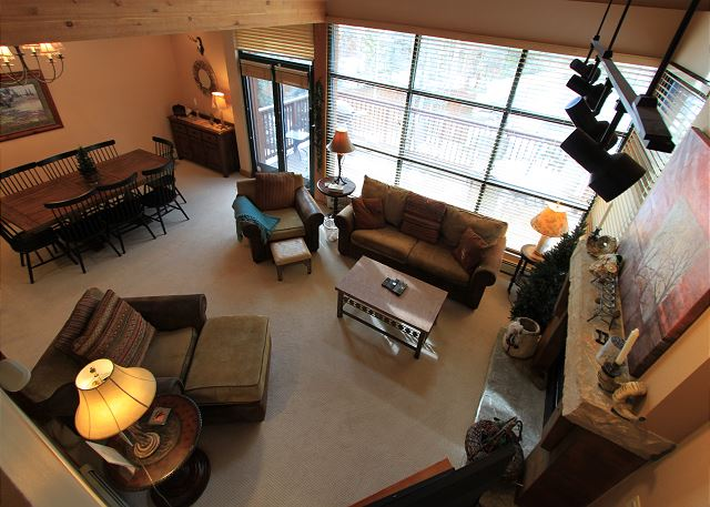 The view of the living area from the first landing on the stairs.