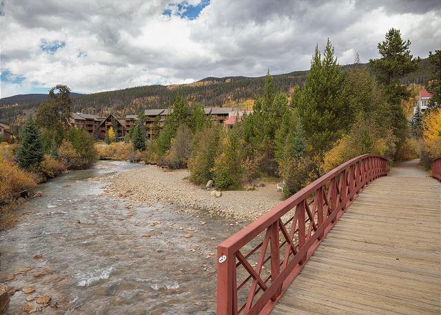 A pedestrian bridge crosses Snake River to the Mountain House Base Area.