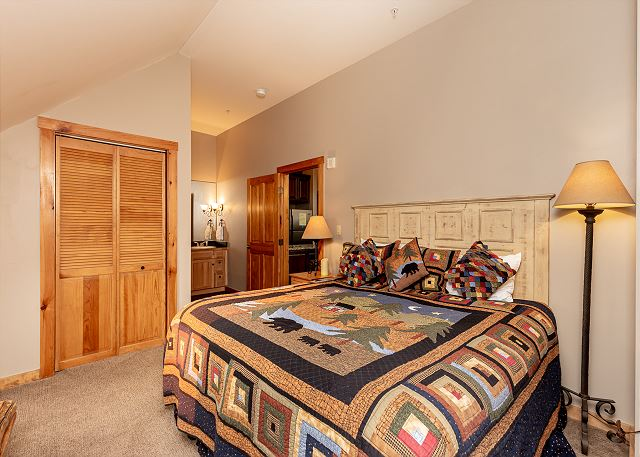 The master suite features a king-sized bed and a flat screen TV.