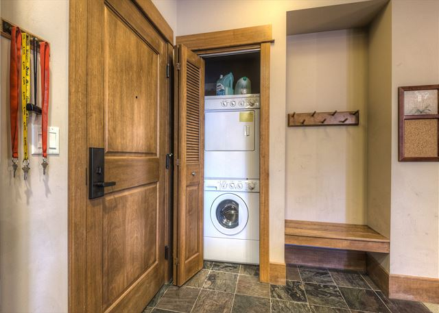 Private laundry and storage area for vacation gear.