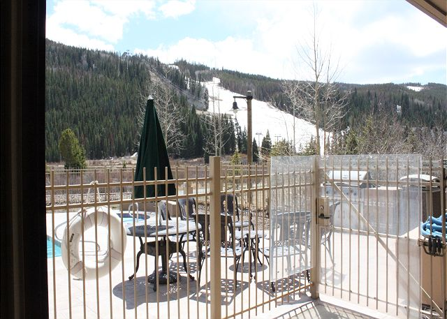 Private Patio offers a view of the ski slopes and the community pool.
