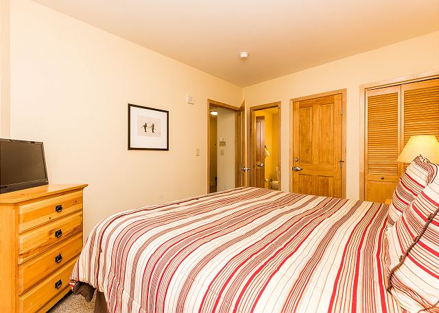 The bedroom features a king-sized bed, a flat screen TV and its own access to the guest bathroom.