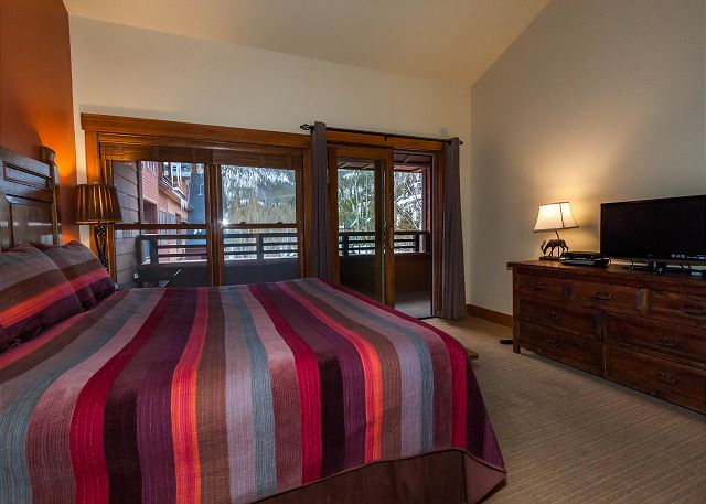 The first master bedroom features a king-sized bed, a flat screen TV and its own spacious private balcony.