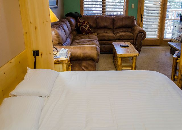 The Murphy bed also features Ivory White Bedding.