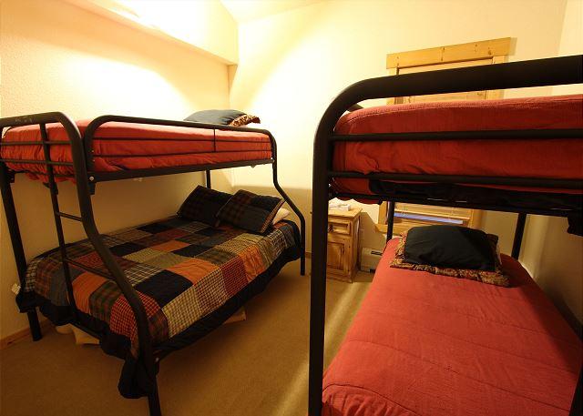 Guest Bedroom that sleeps five with bunk beds.
