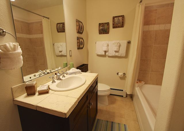 Both guest bedrooms have access to the guest bathroom on the main level.