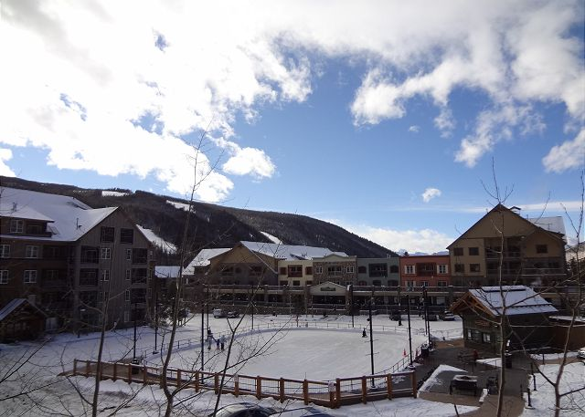 View of the Dercum Square Ice Rink and the ski slopes in the distance.
