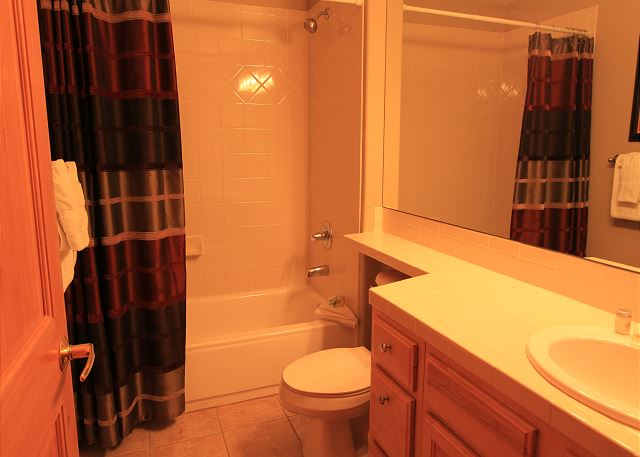 En suite bathroom for second guest bedroom.