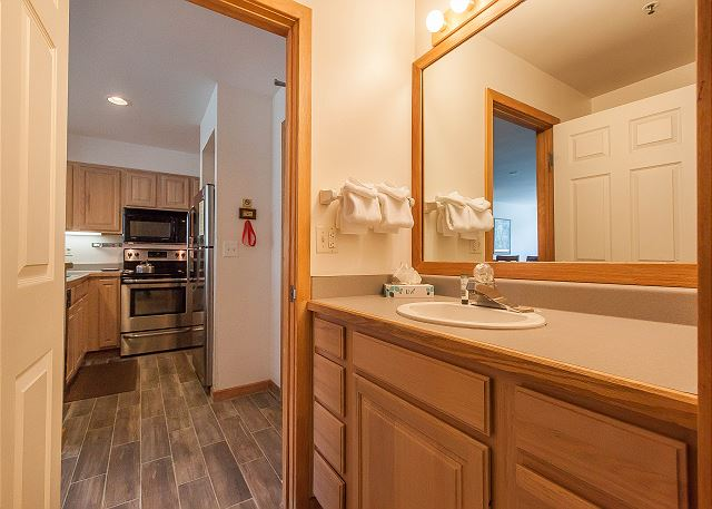 There is a single sink vanity for guests with access to the master bathroom.