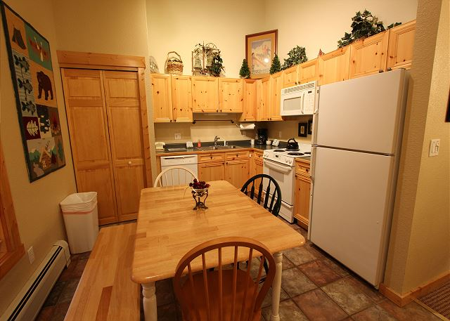 Full-sized eat-in kitchen with seating for five.