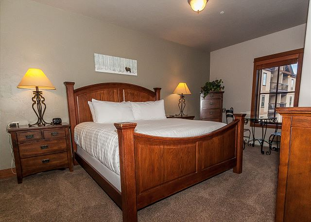 The master suite features a king-sized bed on our Ivory White Bedding program and a flat screen TV. It has its own private entrance and a kitchenette.