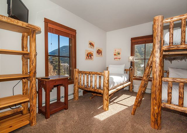 The second guest bedroom features a flat screen TV and twin-sized bunk bed and a twin-sized bed on our Ivory White Bedding program.
