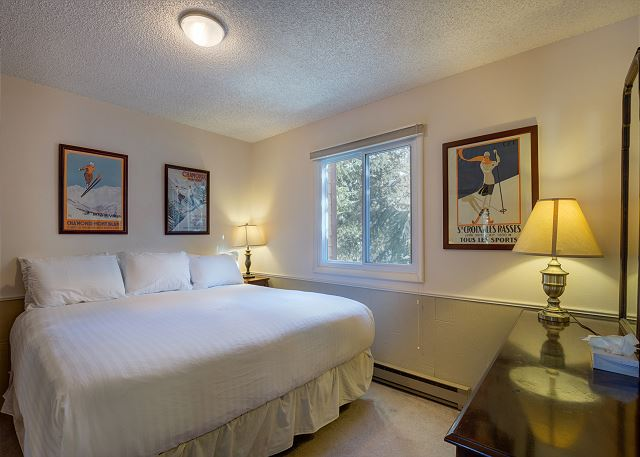 The master bedroom features a king-sized bed on the Ivory White Bedding program.