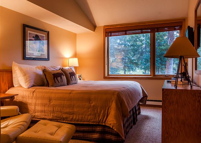 The master bedroom features a king-sized bed, a flat screen TV and scenic views from the windows. (new photo coming soon)
