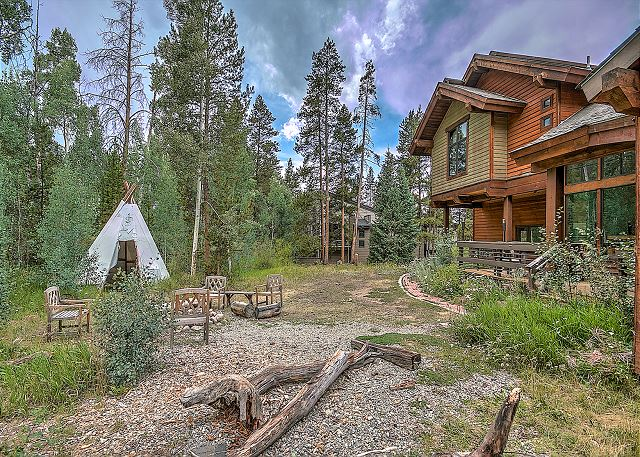 View of the home from the backyard. Enjoy the mountain air by spending the night outside in the teepee, while knowing you are just a few steps from all the luxuries a home provides.