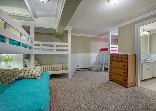 The second bedroom in the basement has three bunk beds and an en suite bathroom.
