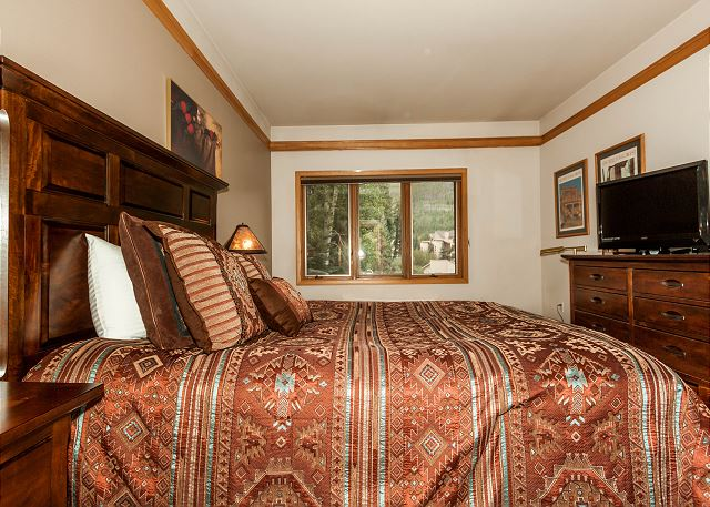 The guest bedroom features a queen-sized bed, a flat screen TV and its own private vanity and access to the guest bathroom.
