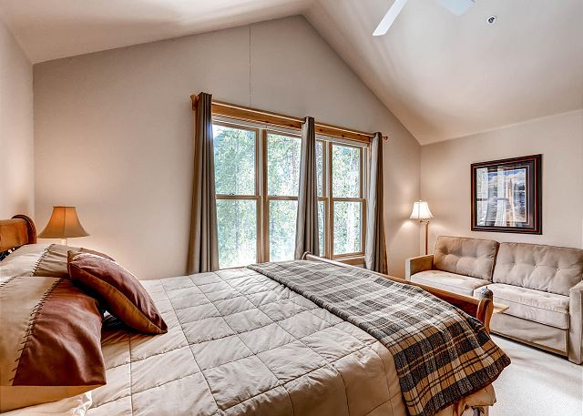 The master bedroom features a queen-sized bed and a flat screen TV as well as a seating area. (new photo coming soon)