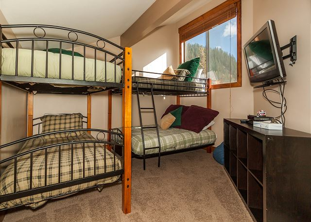 The second bedroom is the upstairs loft. It has a twin-over-twin and twin-over-full bunk beds.