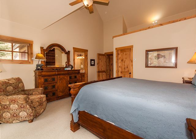 The second master bedroom is upstairs and features a king-sized bed and its own private balcony.