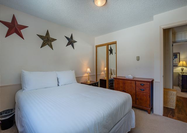 The guest bedroom features a queen-sized bed on the Ivory White Bedding program.