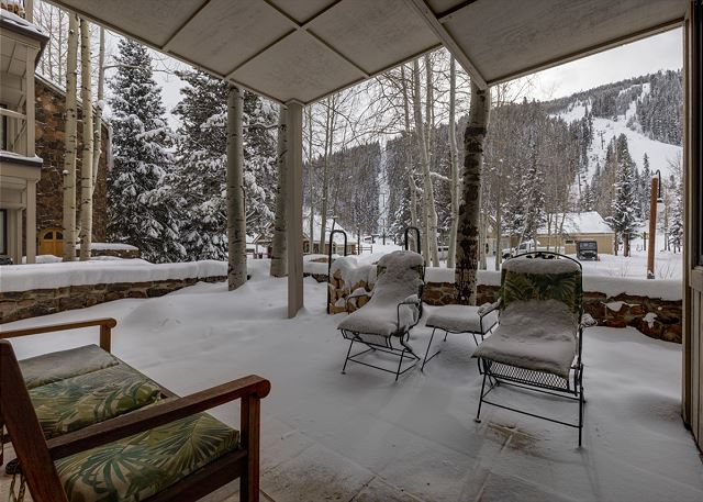 The private covered patio features a view of the lifts, and during the fall you can enjoy the golden Aspens.