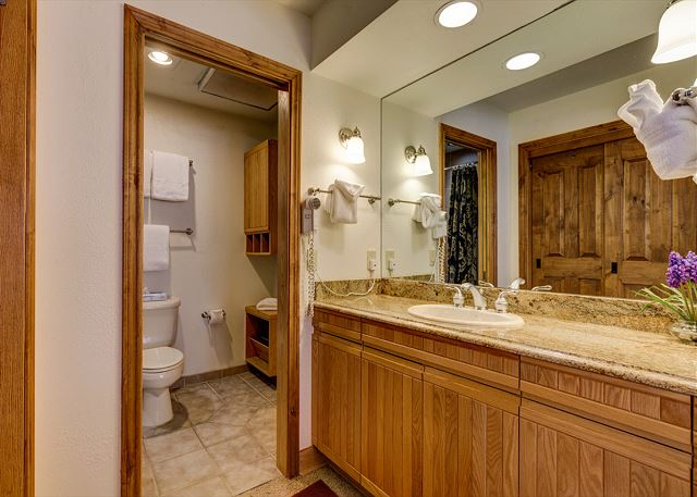 The guest bedroom has its own access to the guest bathroom as well as its own vanity.