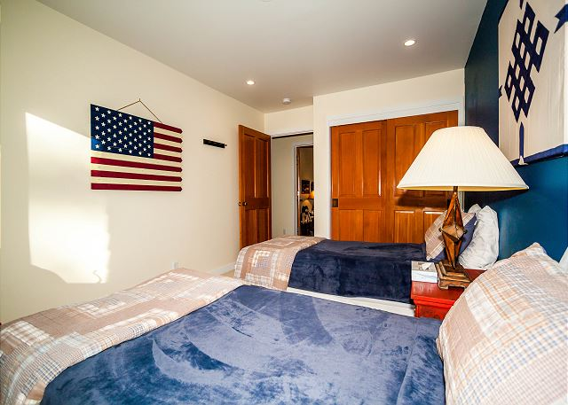 The second guest bedroom features two twin-sized beds.
