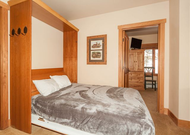 Near the living area is a queen-sized Murphy bed for additional sleeping accommodations.