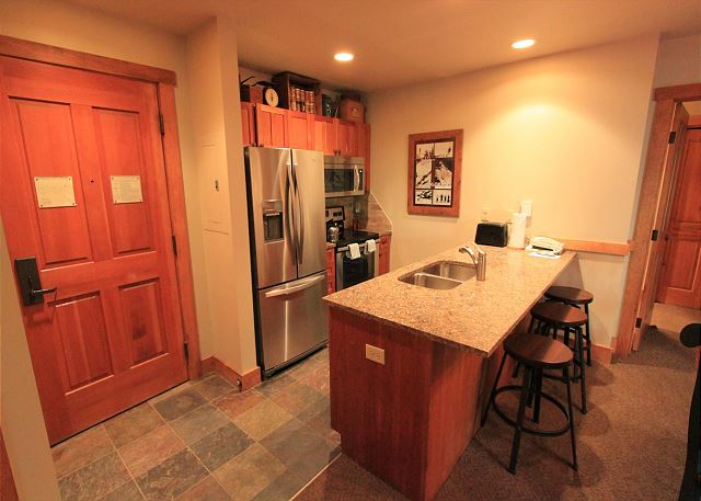 Kitchen features granite counter tops and stainless steel appliances.