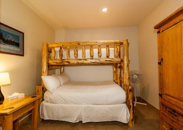 The guest bedroom sleeps three with a twin-over-full bunk bed.