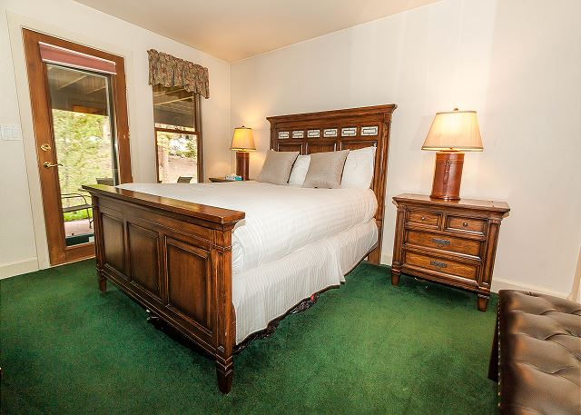 The third master bedroom features a queen-sized bed with Ivory White Bedding, a flat screen TV and access to the private patio.