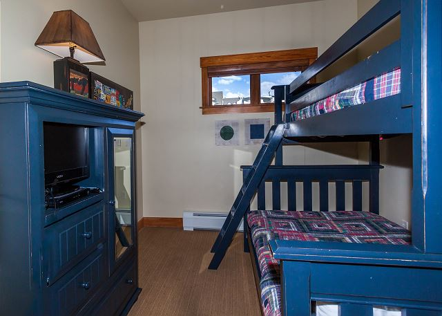 The guest bedroom sleeps three with a twin-over-full bunk bed and also has a flat screen TV.