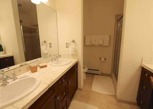 Master bathroom features double sinks.