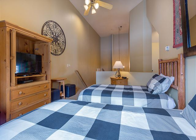 The second guest bedroom is the upstairs loft and features two twin-sized beds and a flat screen TV. It has its own private balcony with beautiful ski slope views.