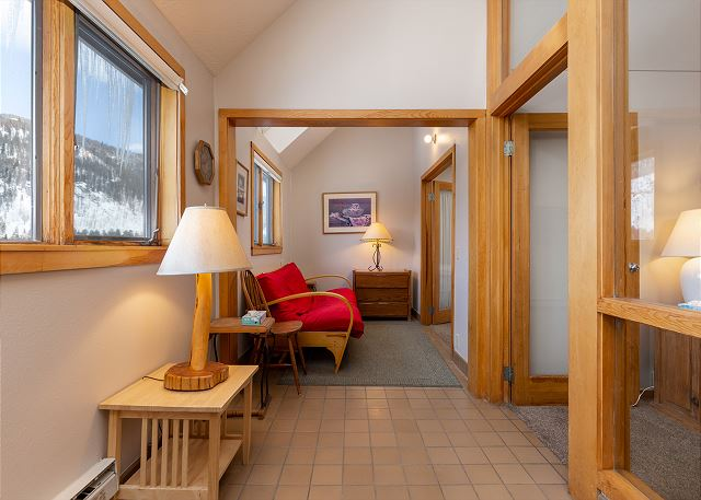 The sunroom offers seating and an additional sleeping arrangement with a futon.