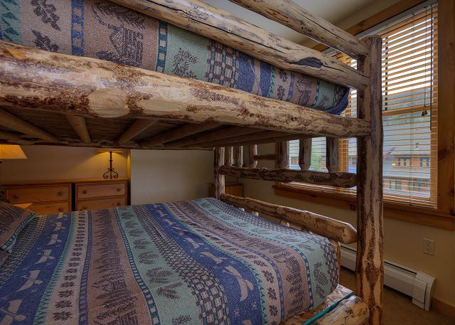 The first guest bedroom features a queen over queen bunk bed with a twin trundle and its own private bathroom.