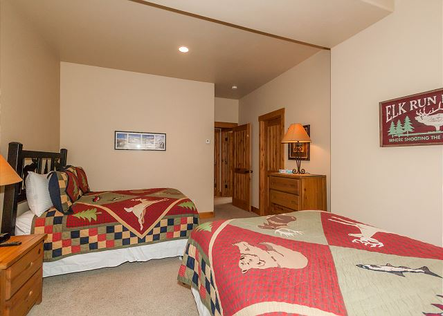 The second guest bedroom is downstairs and features two full-sized beds and its own access to the guest bathroom.