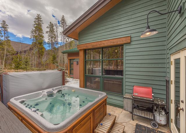 The patio features a private hot tub.