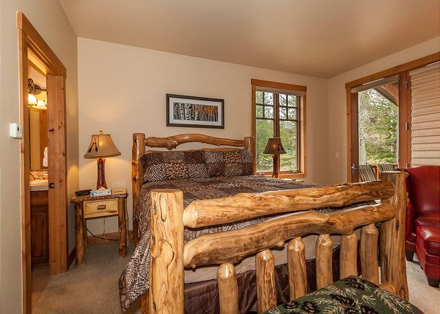 The first master bedroom features a king-sized bed and a private deck access to the hot tub.