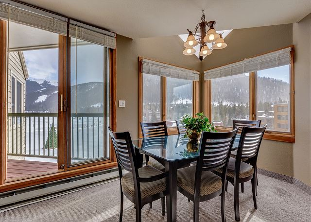 The dining area features large windows with beautiful mountain and lake views.