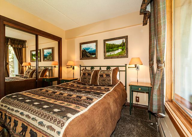 The first guest bedroom features a queen-sized bed, a flat screen TV and its own entrance to the guest bathroom.
