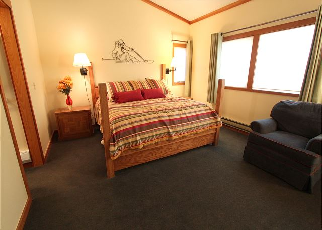 The master bedroom features a king-sized bed, flat screen TV and an en suite bath.